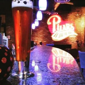 Tall Glass of Cold Beer at Pilars Martini