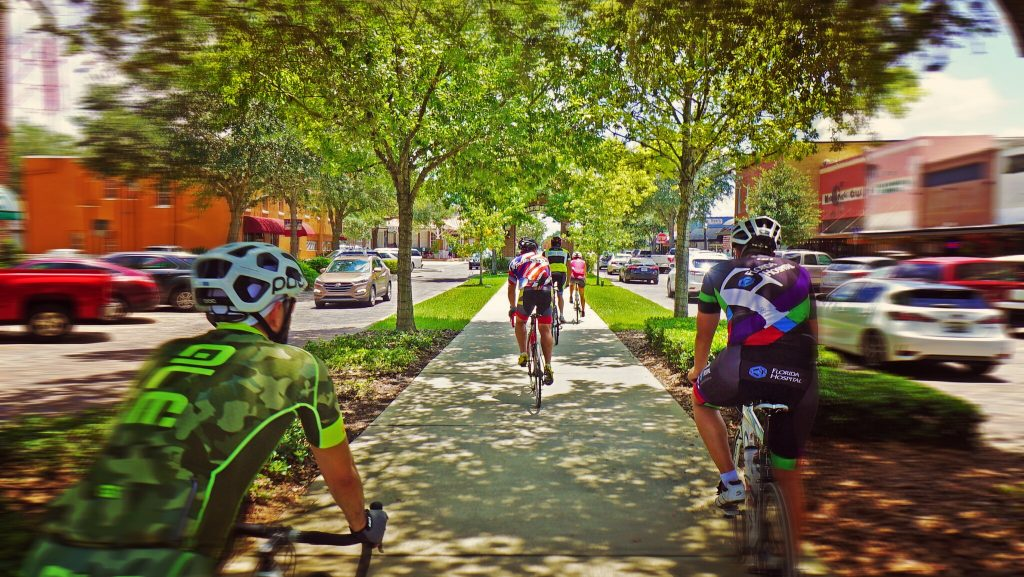 Cyclists riding through Downtown Winter Garden on the West Orange Trail