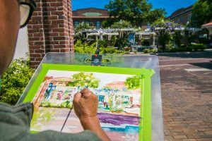 Artist Painting a Picture of Downtown Winter Garden