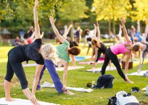 People Practicing Yoga in Downtown Winter Garden
