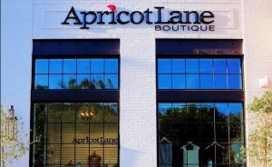 Apricot Lane exterior shot with bench